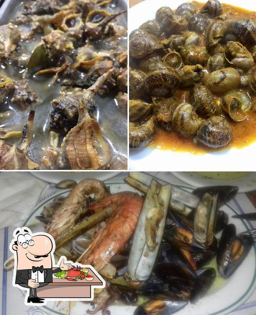 Отведайте блюда с морепродуктами в Bar los Prados 2