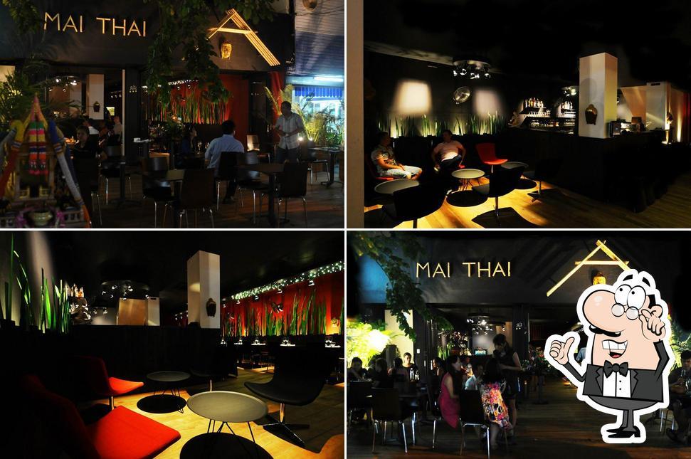 Посмотрите на внутренний интерьер Mai Thai Cuisine