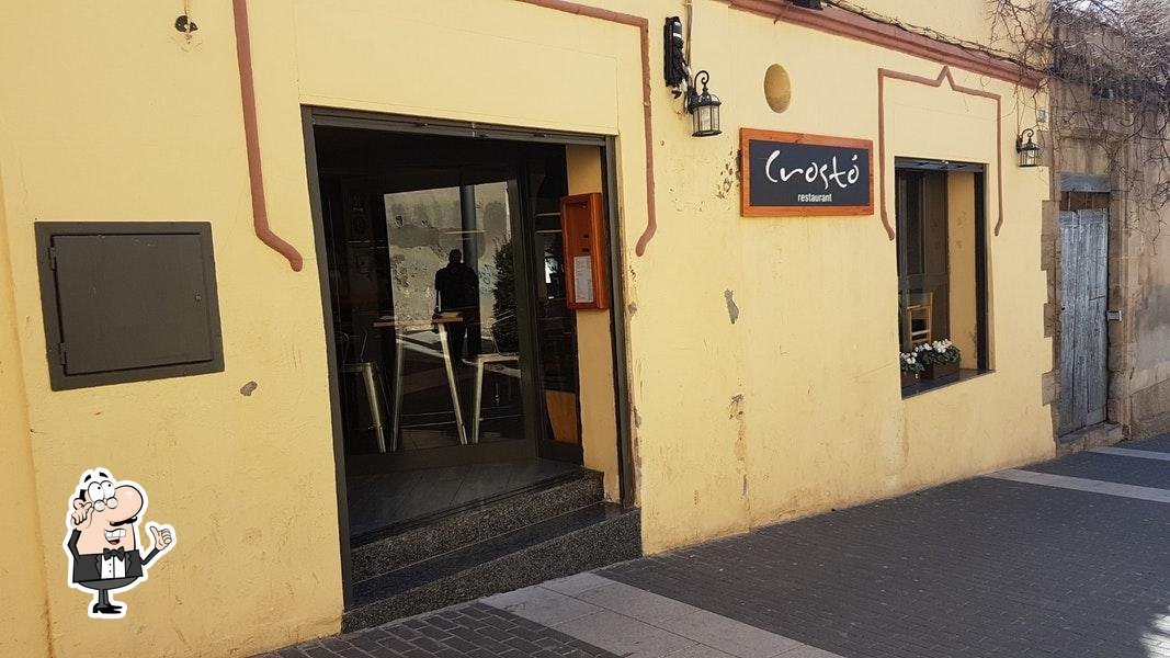 Take a seat at one of the tables at Crostó