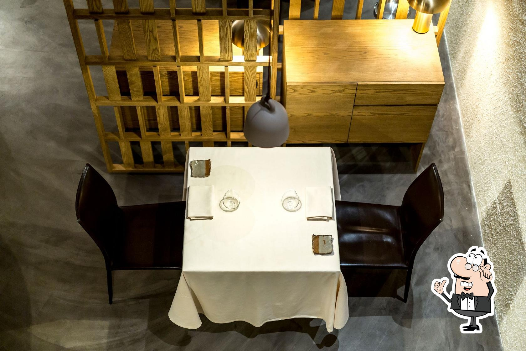 Take a seat at one of the tables at Metamorfosi