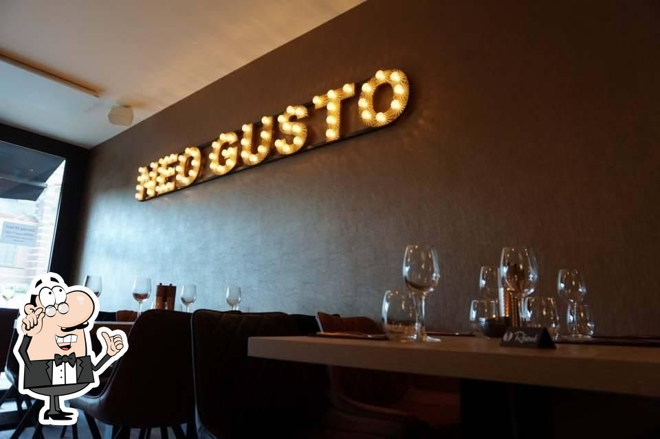 Take a seat at one of the tables at Neo Gusto