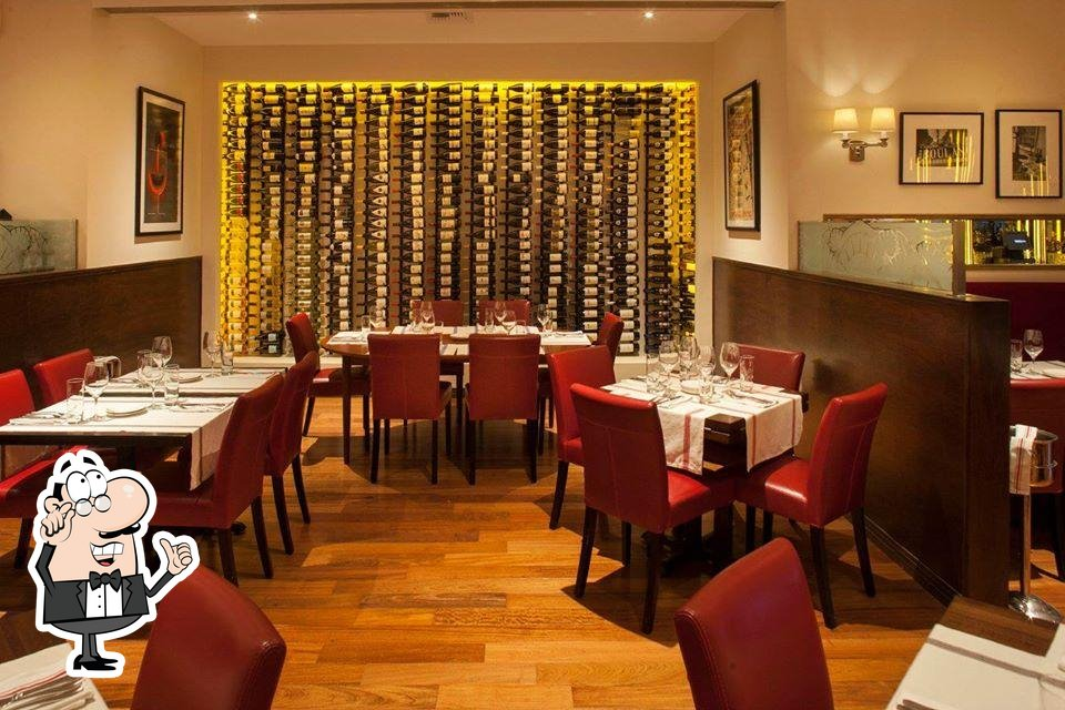 Take a seat at one of the tables at Bistro du Marché by Tapenade
