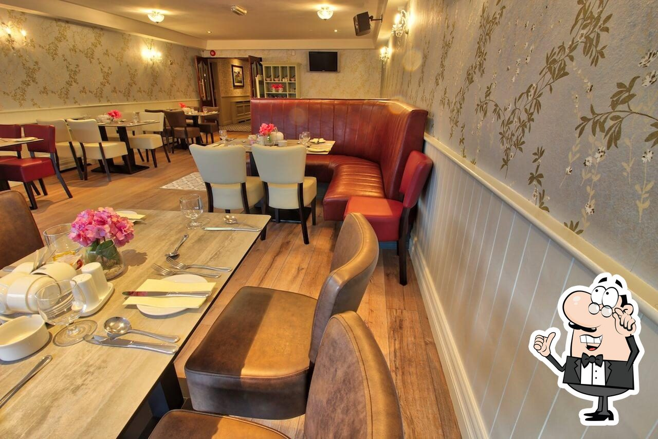 Take a seat at one of the tables at The Valley Inn