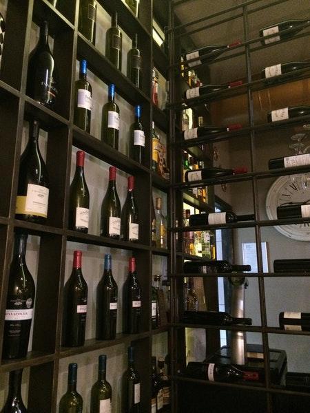 Savour a glass of wine at Ρόδι & Μέλι