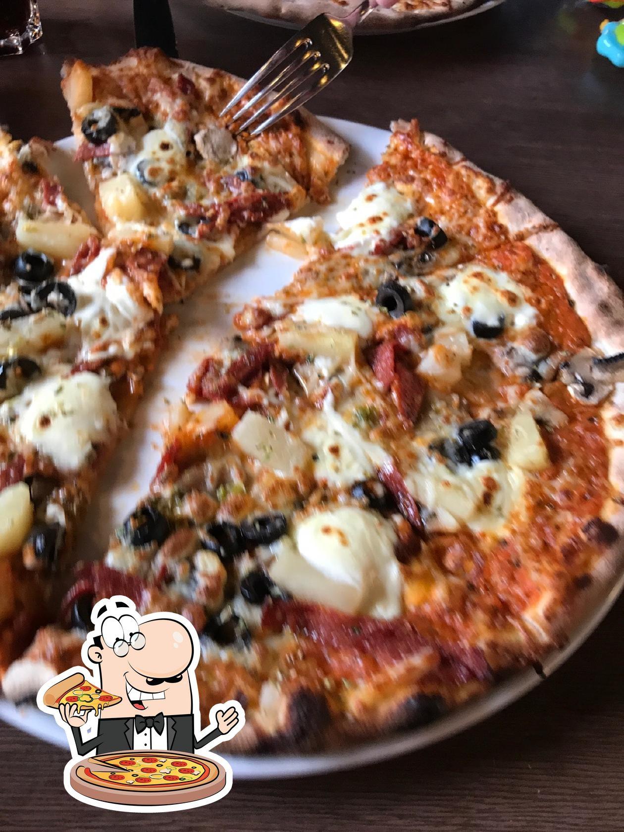 En Eldofninn, puedes saborear una pizza