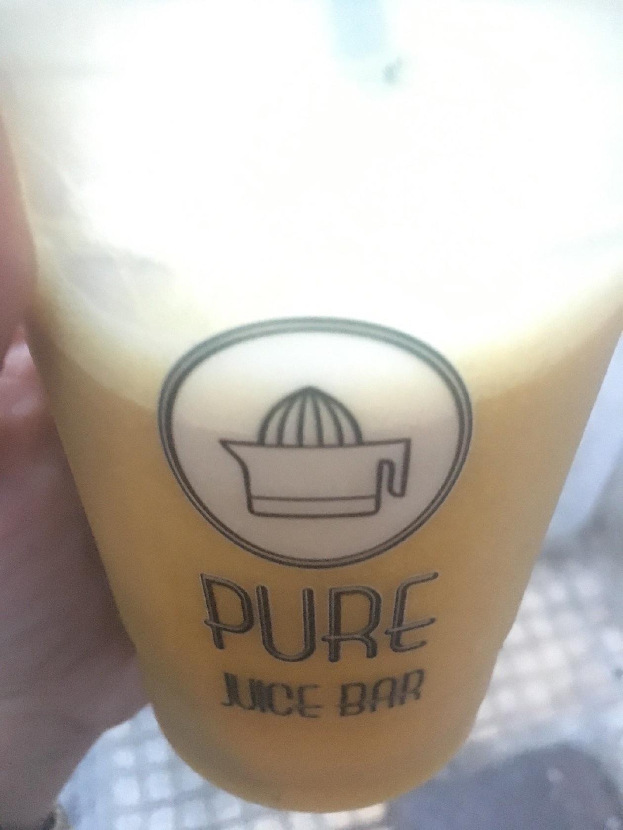 The logo of PURE Juice Bar