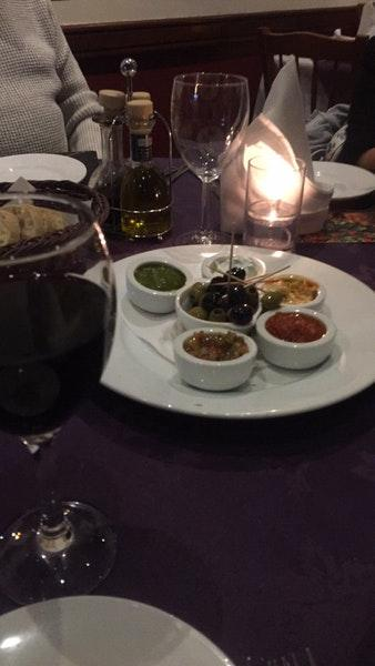 Order a glass of wine at Amici