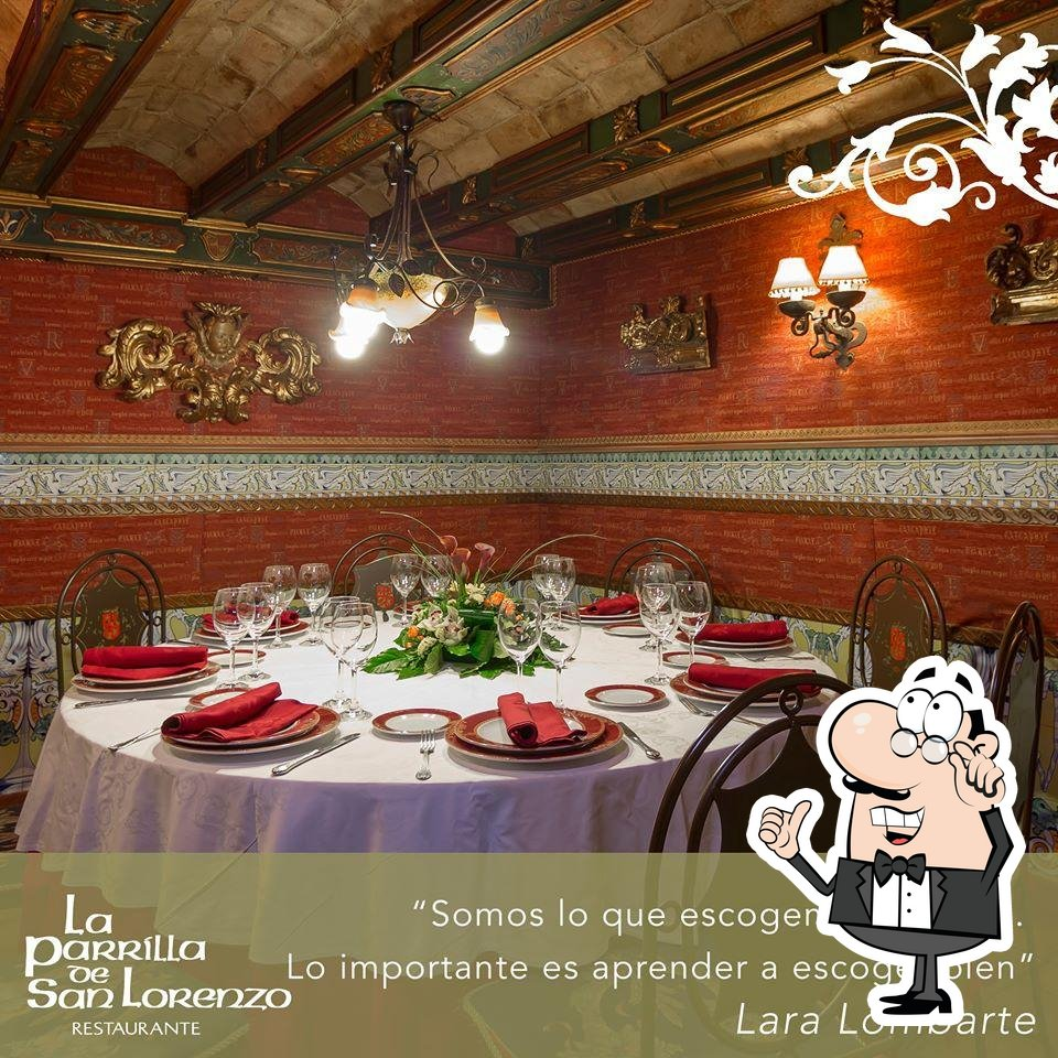 Take a seat at one of the tables at La Parrilla de San Lorenzo