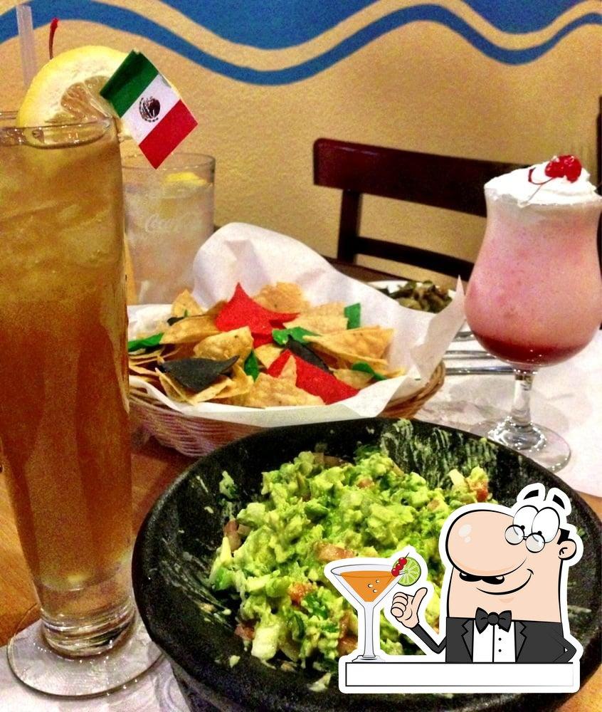 Order a drink at Juan's Flaming Fajitas & Cantina